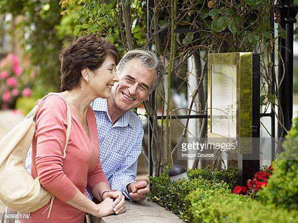 Couple looking at restaurant menu