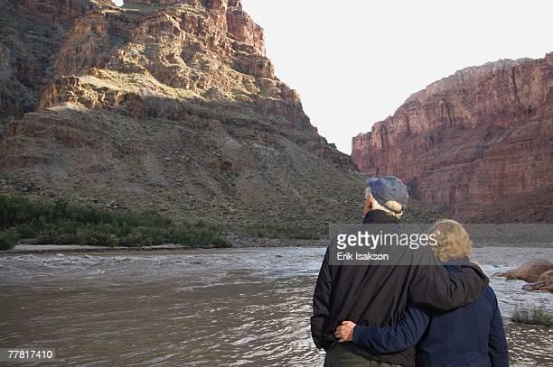 Couple looking at river, Colorado River, Moab, Utah, United States