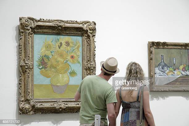 A couple looking at some paintings in the Philadelphia Museum of Art
