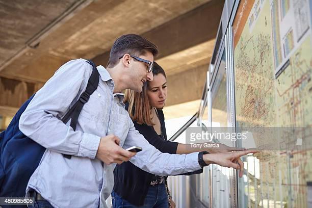 Couple looking at subway map, Los Angeles, California, USA