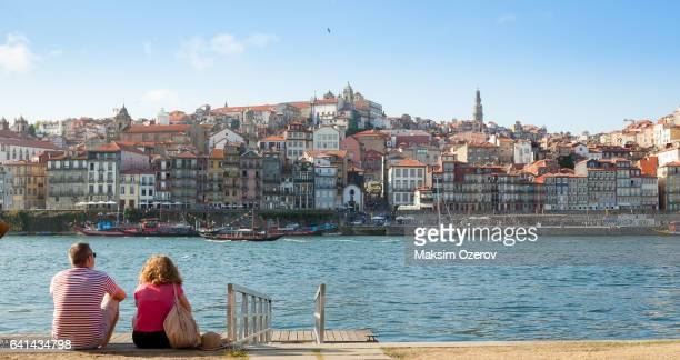 couple looking at the historic center of porto, portugal - porto portugal stock pictures, royalty-free photos & images