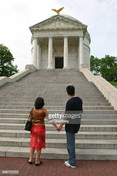 A couple looking at the Illinois Memorial