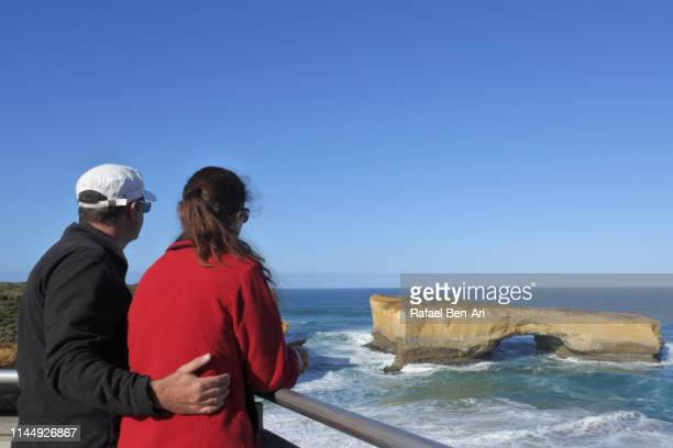 Couple looking at the landscape view of London Bridge Port Campbell National Park Victoria Australia