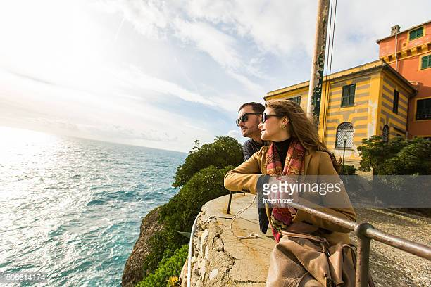 couple looking at the sea - portofino stock pictures, royalty-free photos & images