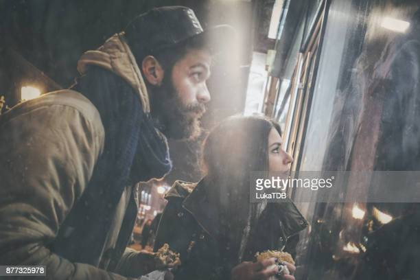 Couple looking at the shop window