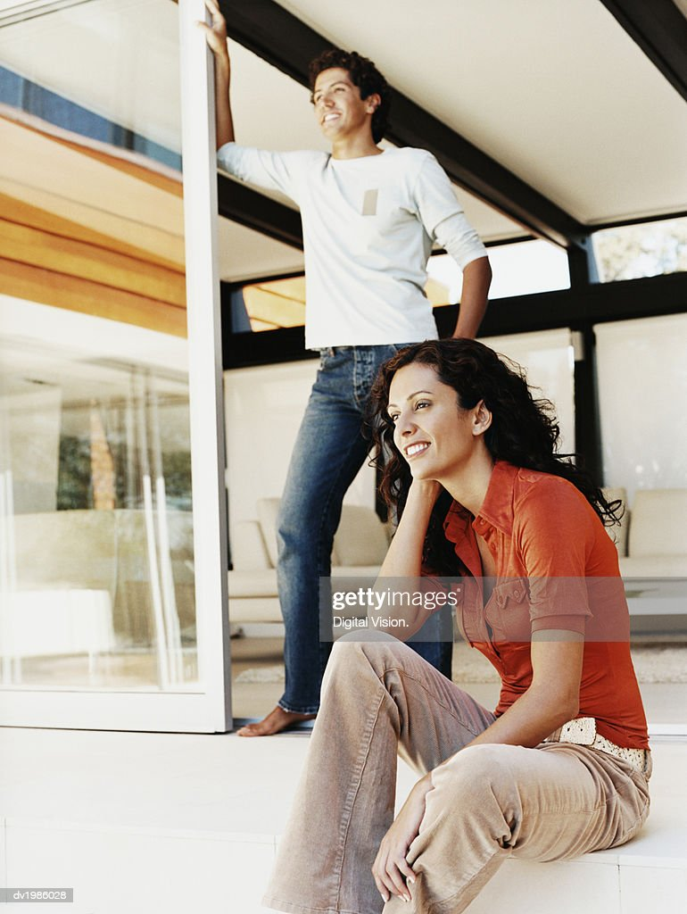 Couple Looking at the View From the Steps of Their Patio : Stock Photo