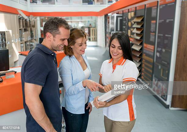 Couple looking at wood samples at a furniture store