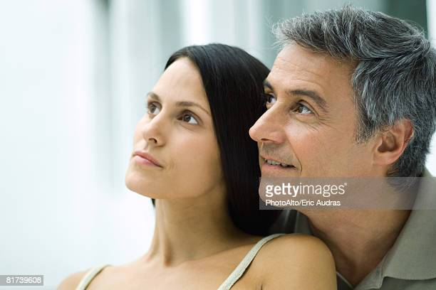 couple, looking away, portrait - may december romance stock photos and pictures