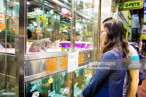 Couple looking for cats at Chinese pet store in Kowloon