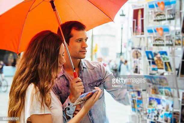 Couple looking for Tourist Postcards Barcelona Ramblas