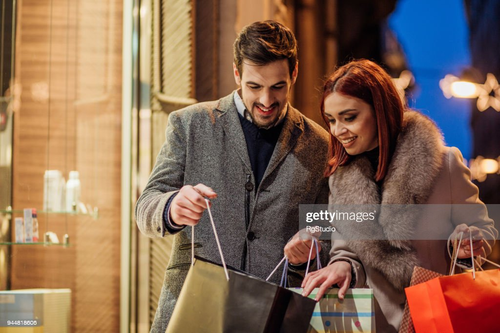 Couple looking in shopping bag : Stock Photo