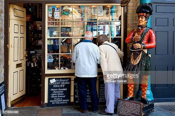 Couple looking in store window in Covent Garden Market