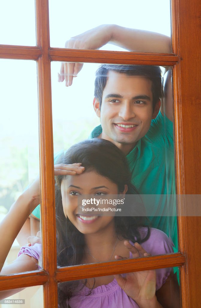 Couple looking inside new house : Stock Photo