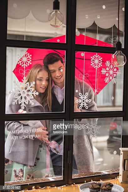 Couple looking into cake shop window