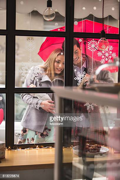 Couple looking into cake shop window