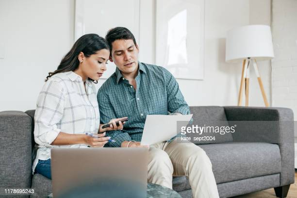 couple looking on bank statements - stock market data stock pictures, royalty-free photos & images