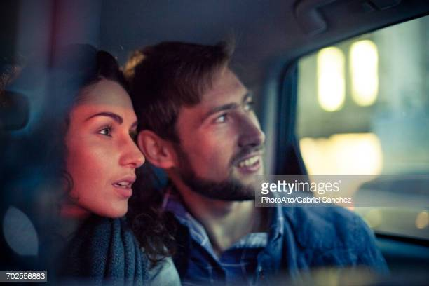 couple looking out car window at night - awe stock pictures, royalty-free photos & images