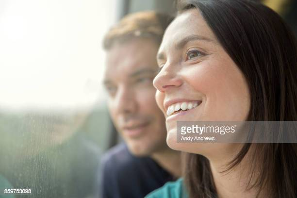 Couple looking out of a train window