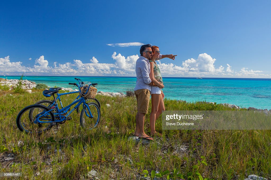 Couple looking the horizon : Stock Photo