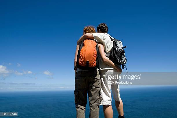 couple looking the view - cargo pants stock photos and pictures