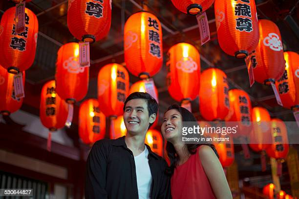Couple looking up at red lanterns
