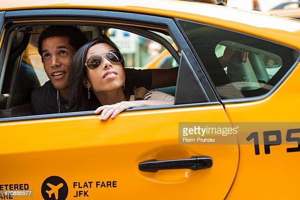 Couple looking up from cab window