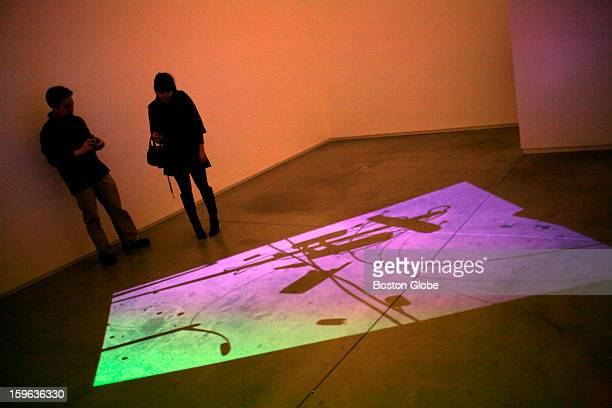 Couple looks at a projected exhibit at the Institute of Contemporary Art, Thursday, Nov. 1, 2007.