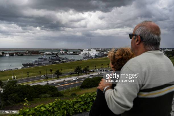 A couple lookS at Argentina's Navy destroyer ARA Sarandi being refueled after taking part in the search of missing submarine ARA San Juan at...