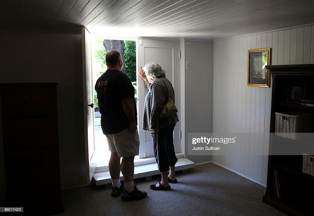 A couple looks out at a yard as they walk through an open house during a brokers tour July 23, 2009 in San Rafael, California. The National Association of Realtors reported today that sales of existing homes were up for the third consecutive month, rising 3.6 percent in June.
