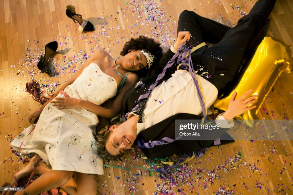 Couple lying down on the floor : Stock Photo