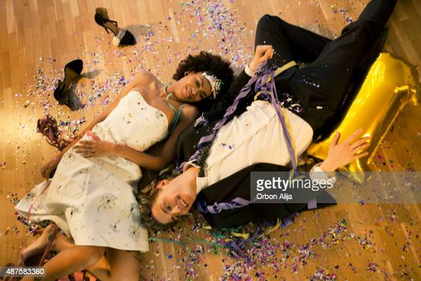 couple lying down on the floor - after party stockfoto's en -beelden