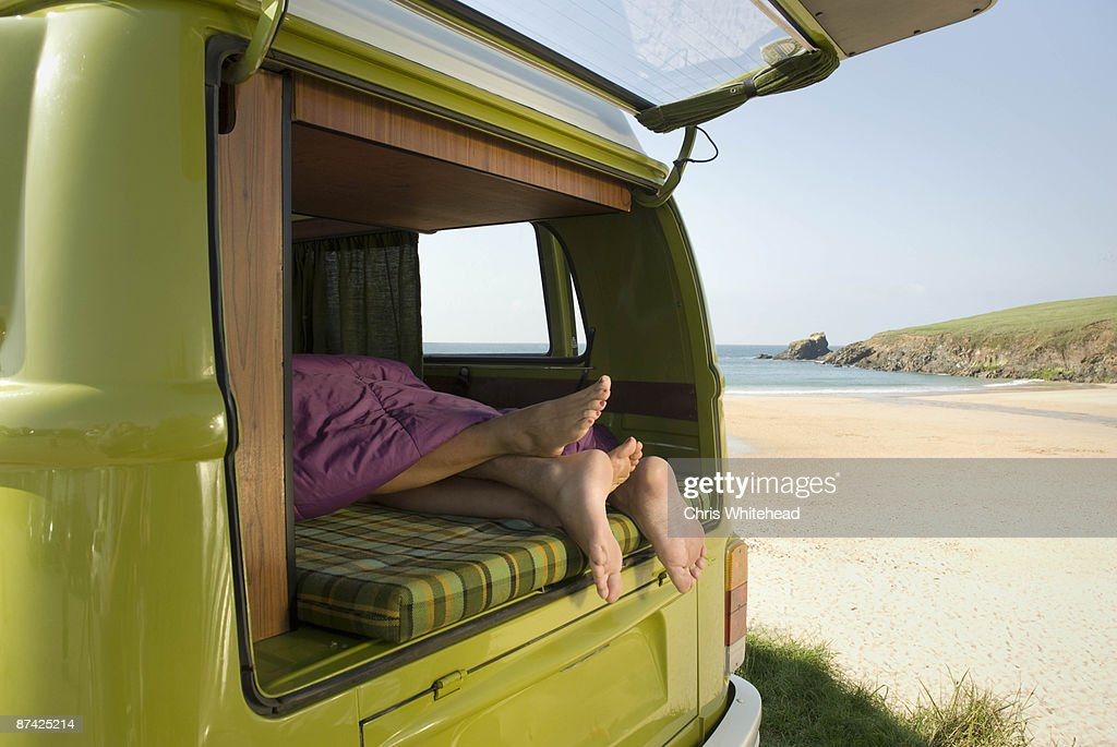 Couple lying in camper van : Stock Photo