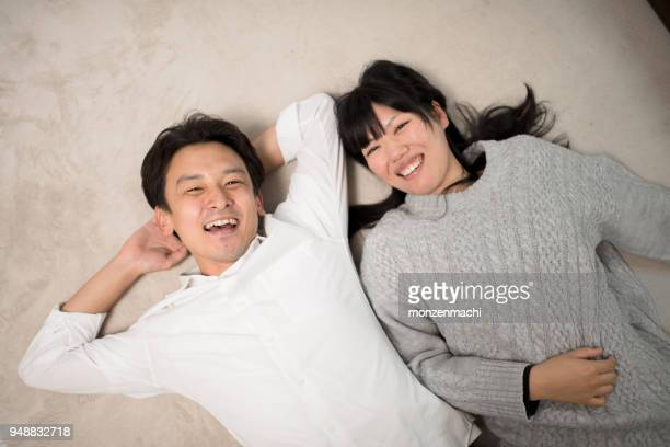 couple lying in living room