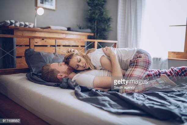 couple lying in the bed - good morning kiss images stock photos and pictures