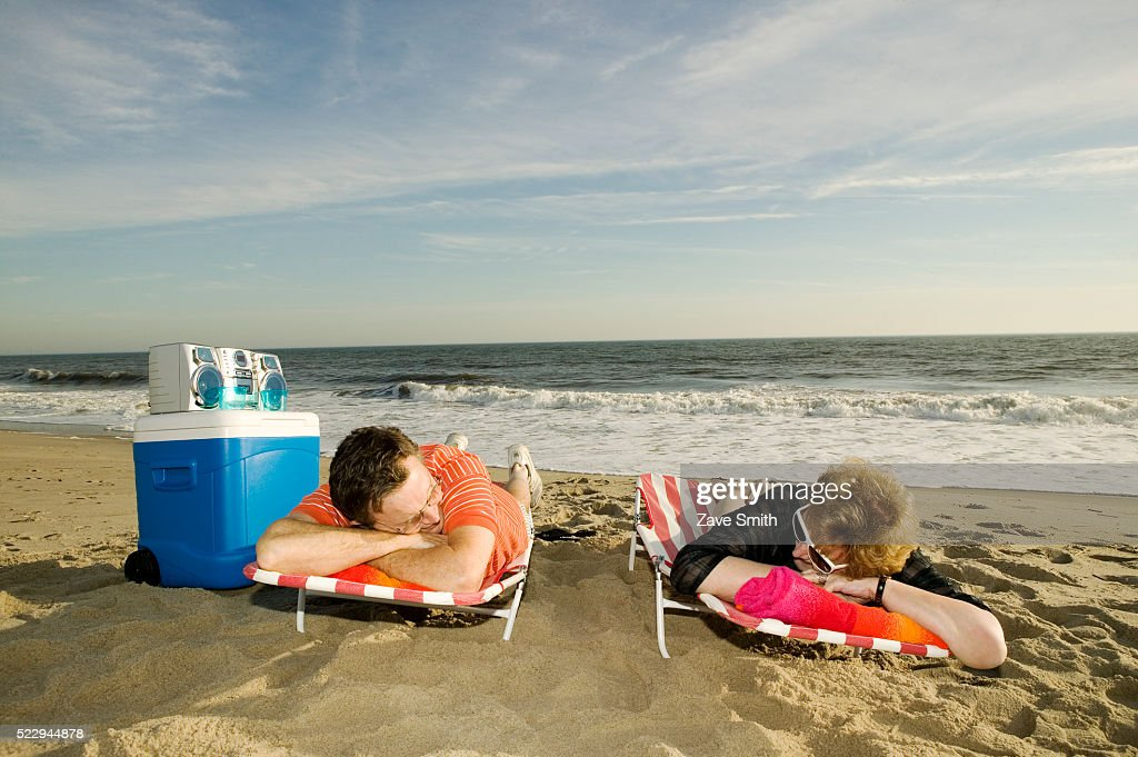 Lying On Beach Chairs Stock Photo