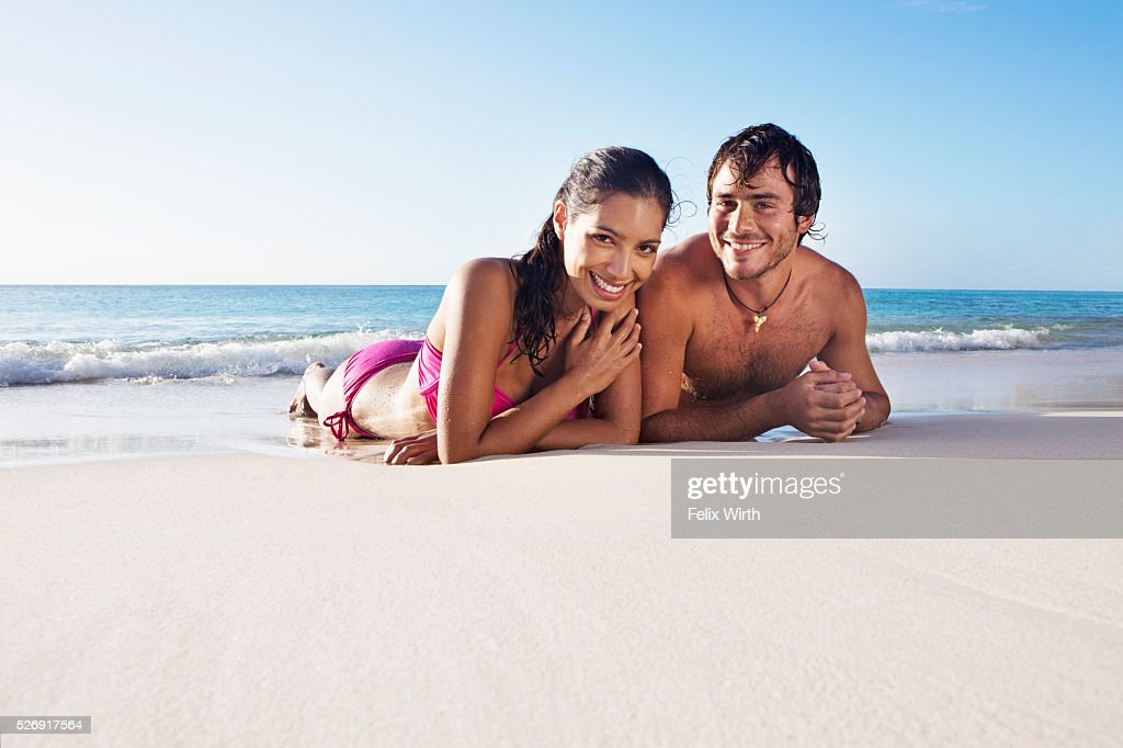 Couple lying on beach : ストックフォト