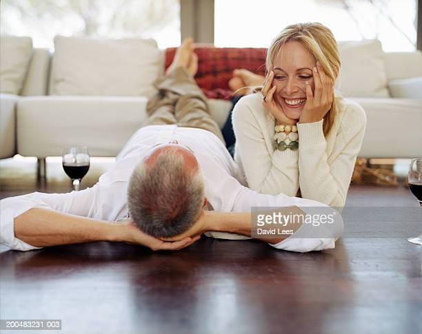 Couple lying on floor in living room