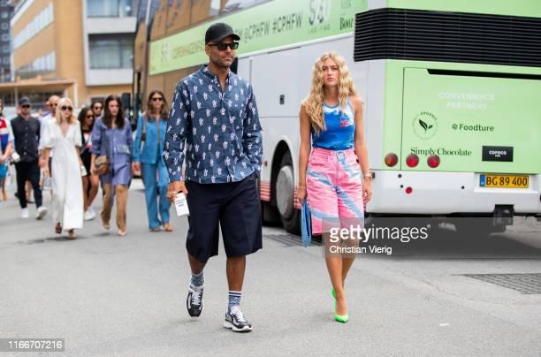 Couple Mads Emil and Emili Sindlev is seen outside Holzweiler during Copenhagen Fashion Week Spring/Summer 2020 on August 07, 2019 in Copenhagen,...