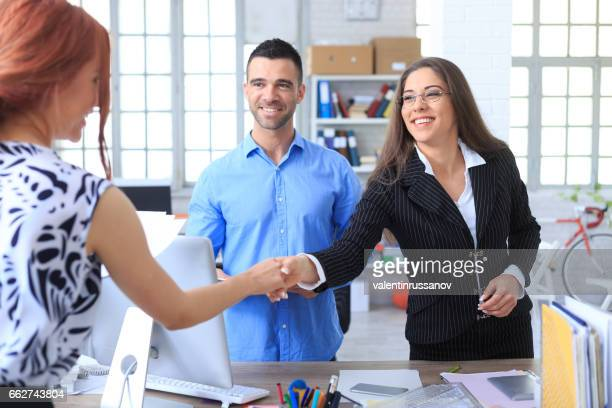 couple making agreement in office - ginger banks stock pictures, royalty-free photos & images