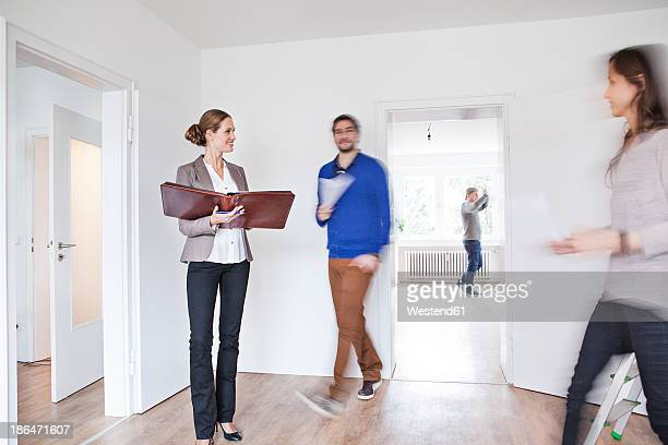 Couple making an agreement with estate agent