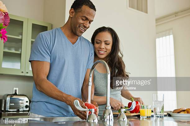 couple making breakfast in loft apartment - couples showering together stock photos and pictures