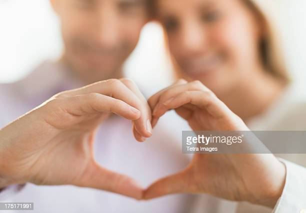 couple making heart shape with hands - human finger stock pictures, royalty-free photos & images