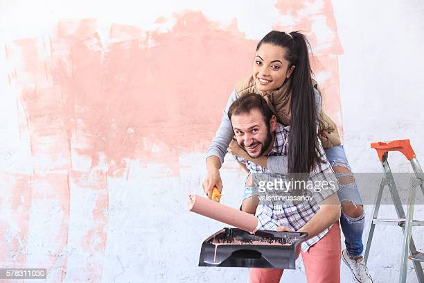 Couple making home improvement in piggyback