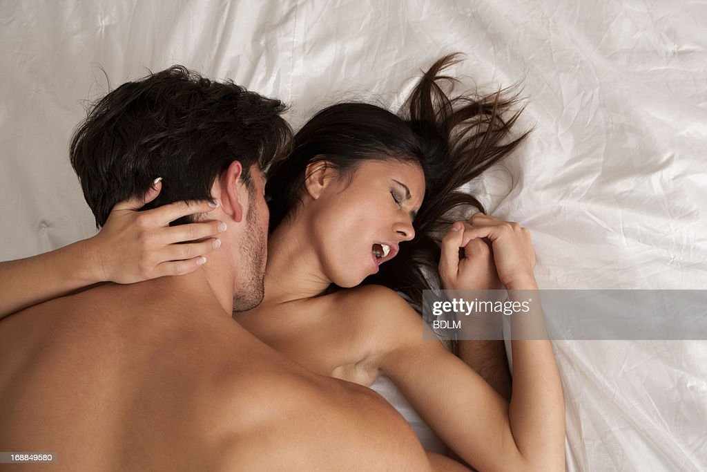 Man and woman having sex on bed