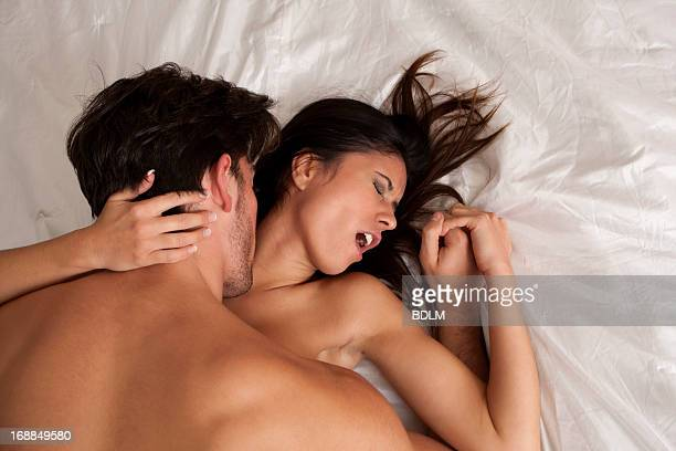 couple making love in bed - male female nude stock pictures, royalty-free photos & images
