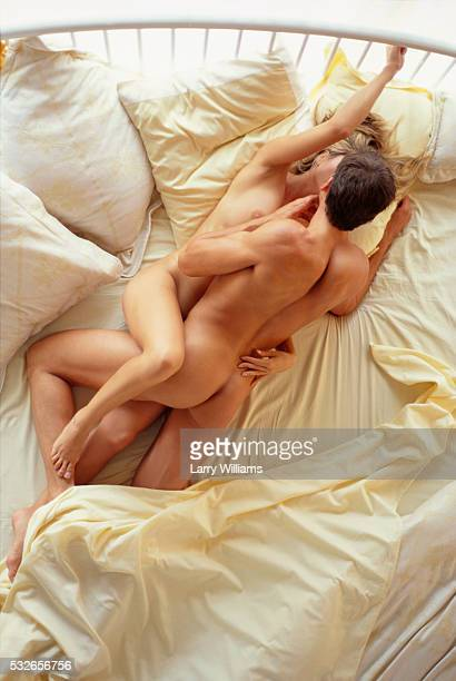couple making love in bed - couples making passionate love stock pictures, royalty-free photos & images