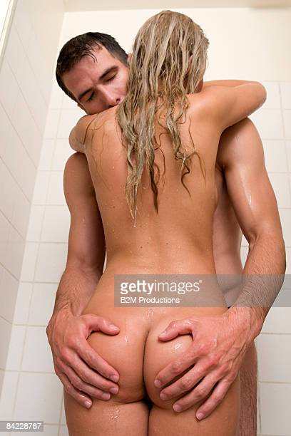 couple making love in shower - bare bottom women stock photos and pictures