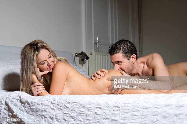 couple making love on bed - bare bottom women stock photos and pictures