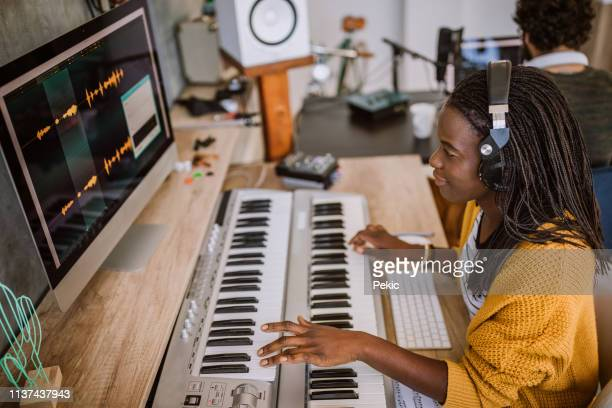 couple making music in studio - electronic music stock pictures, royalty-free photos & images