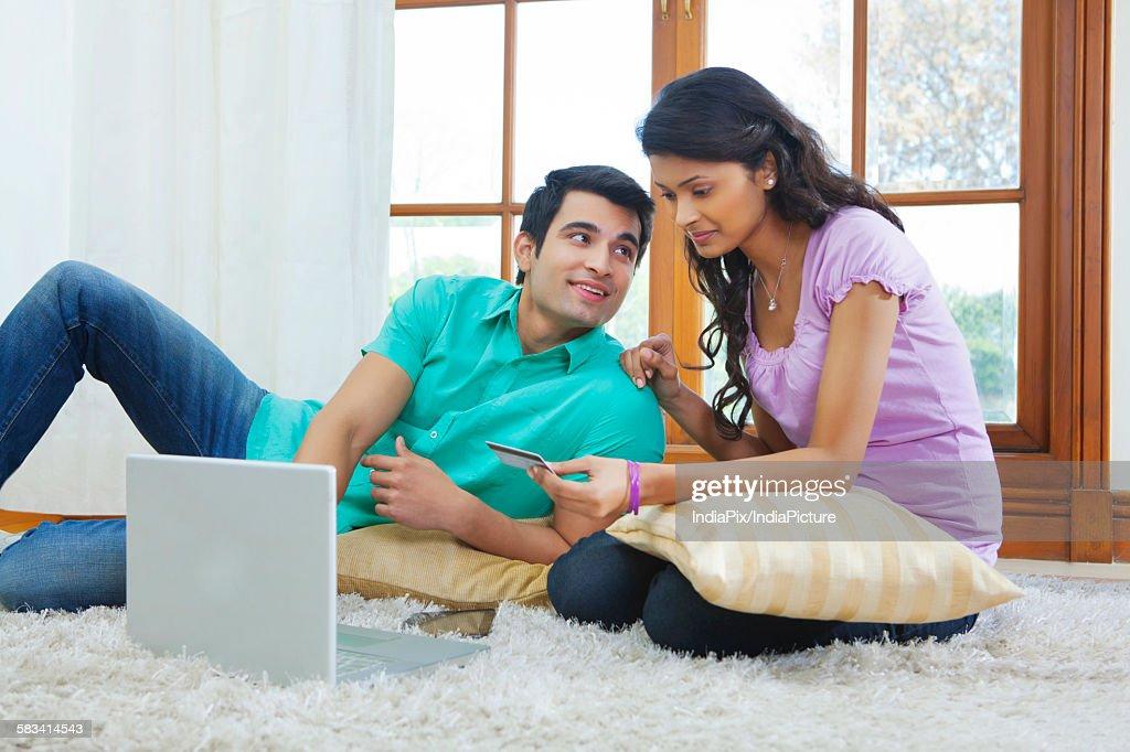 Couple making online transaction : Stock Photo